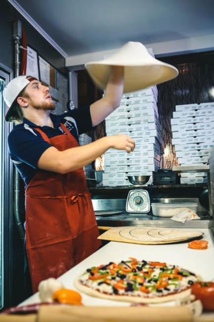 Man Tossing Pizza Crust
